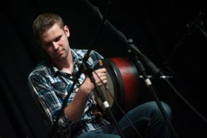Corey Purcell playing the Bodhran